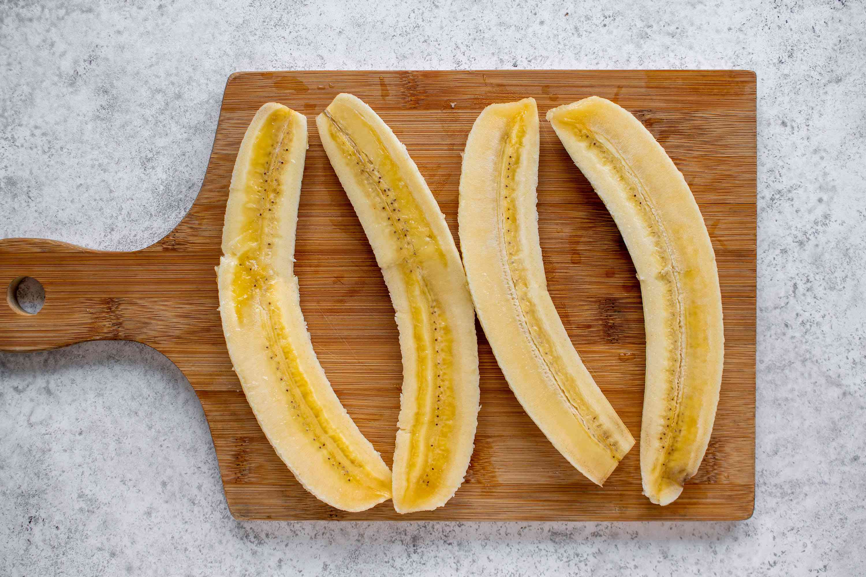 Peel and halve each banana lengthwise