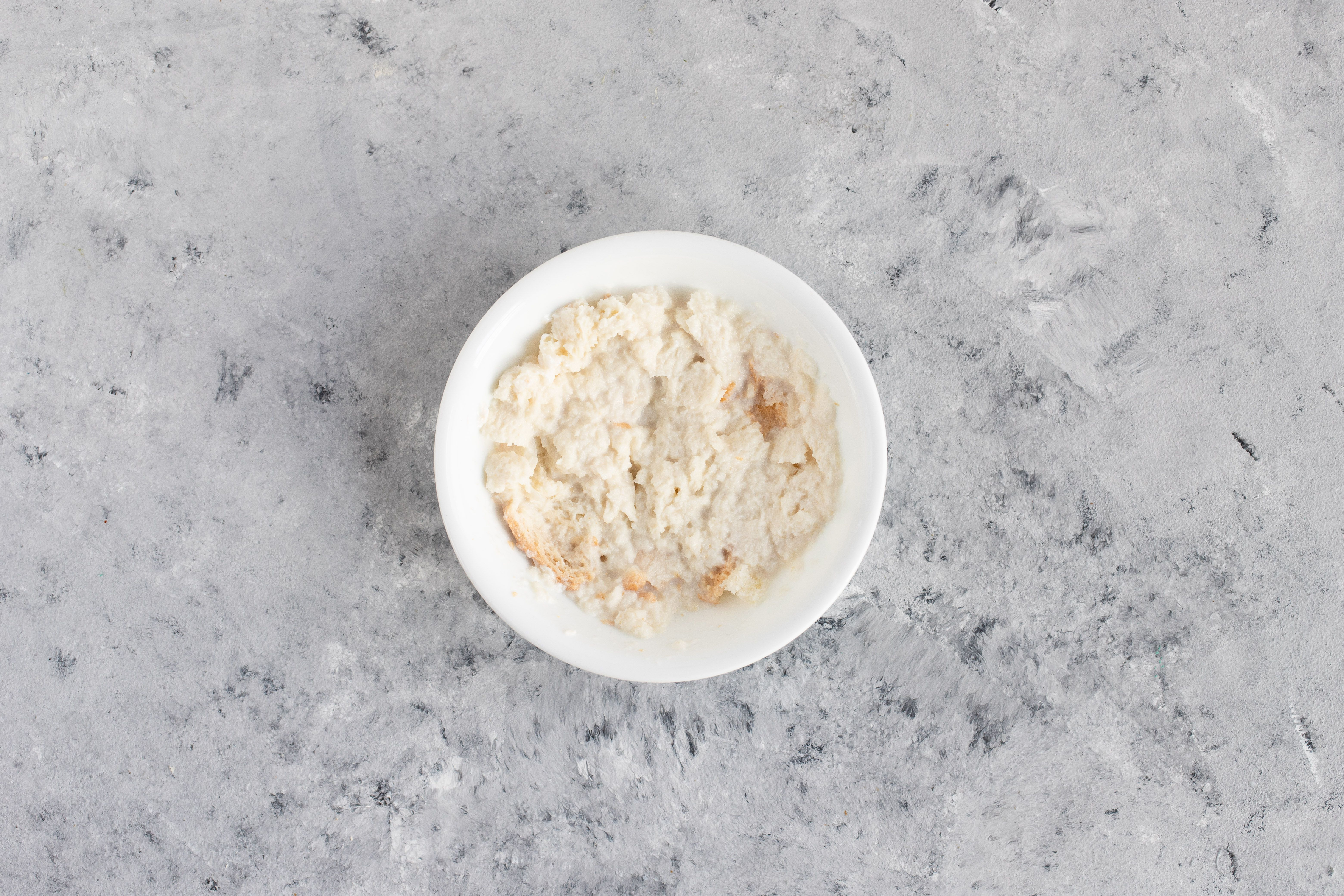bread and milk mashed together in a small bowl