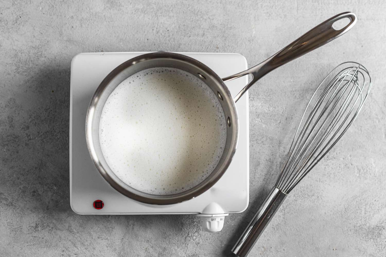 frothed milk in a saucepan