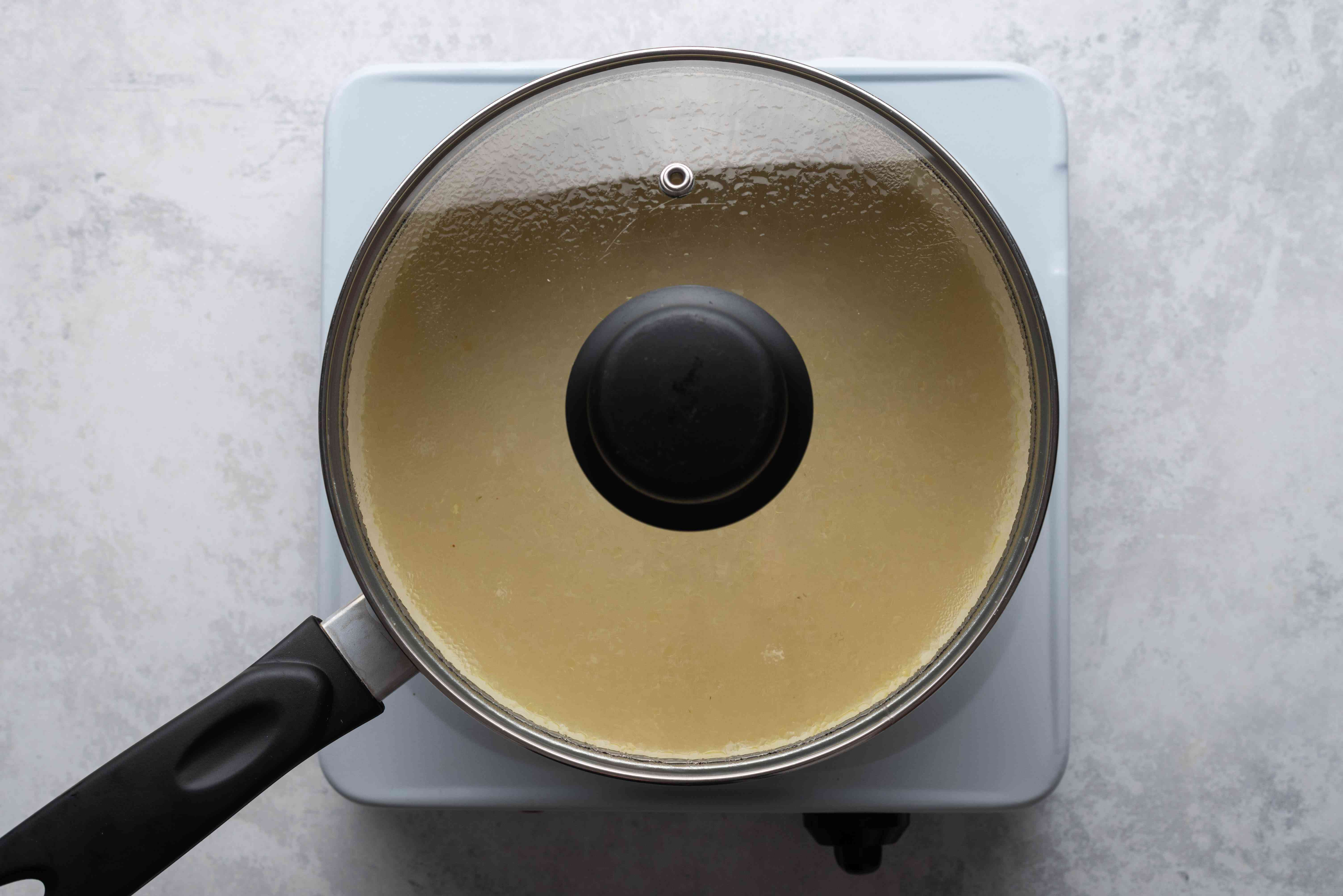 rice cooking in a covered pot