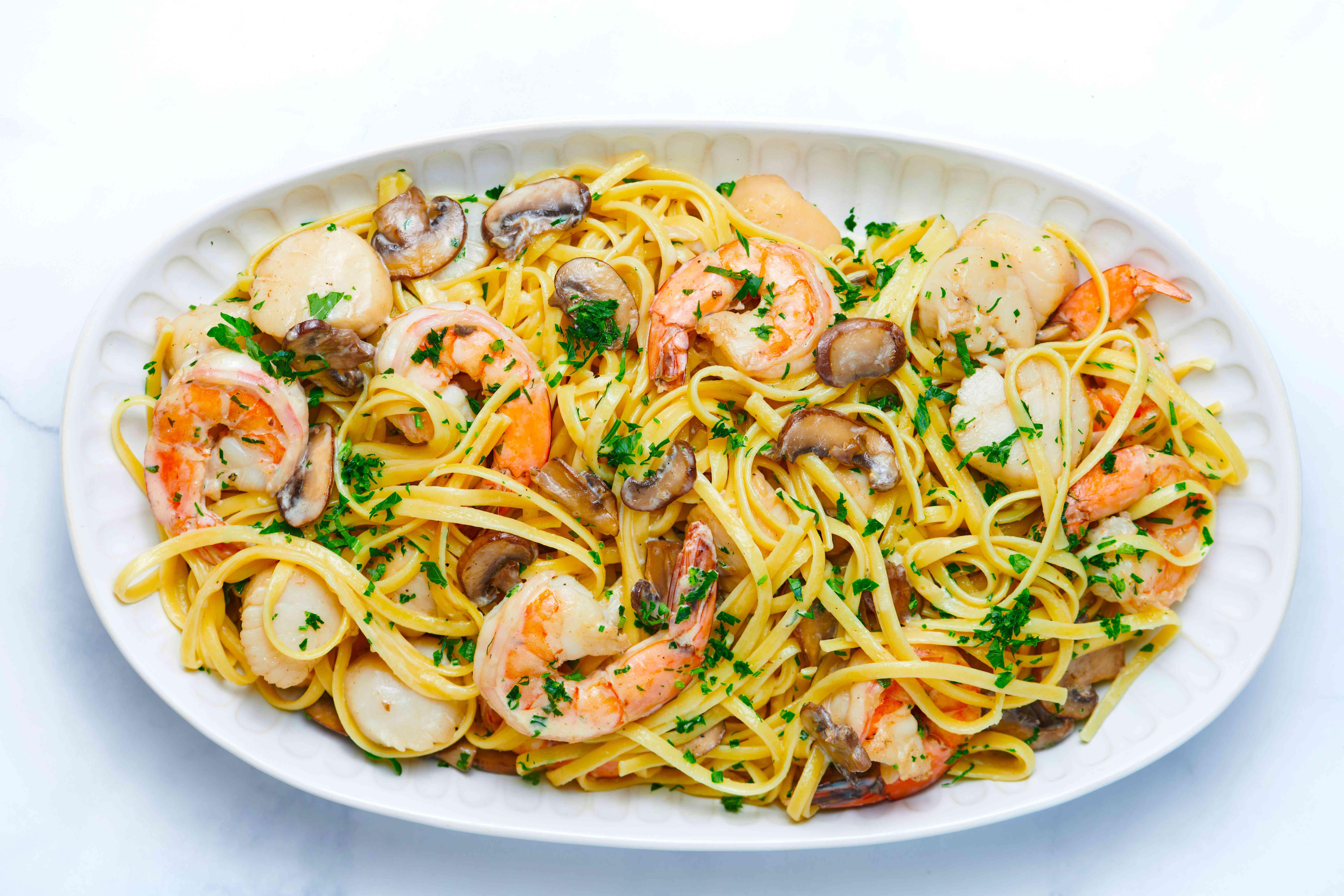 Seafood Pasta With Mushroom Cream Sauce on a platter