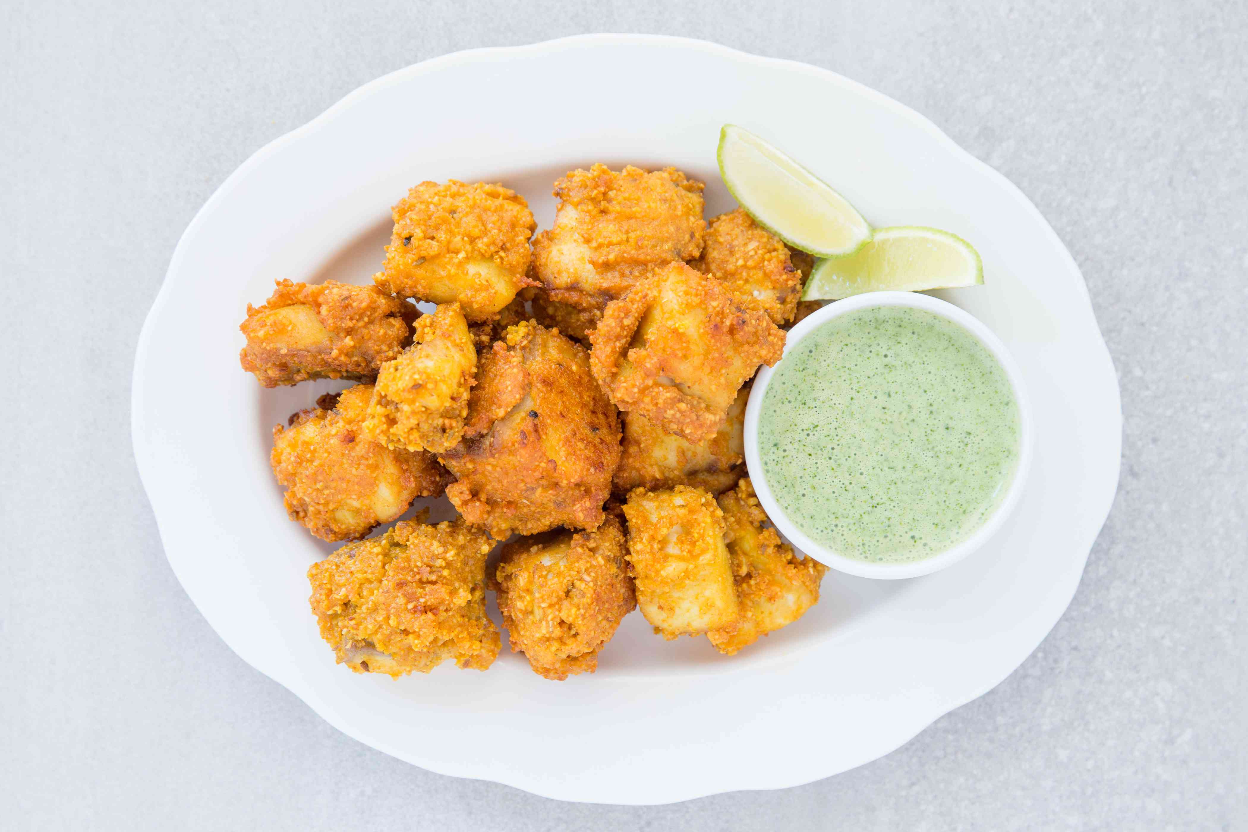 Fish Pakora on a plate, served with sauce