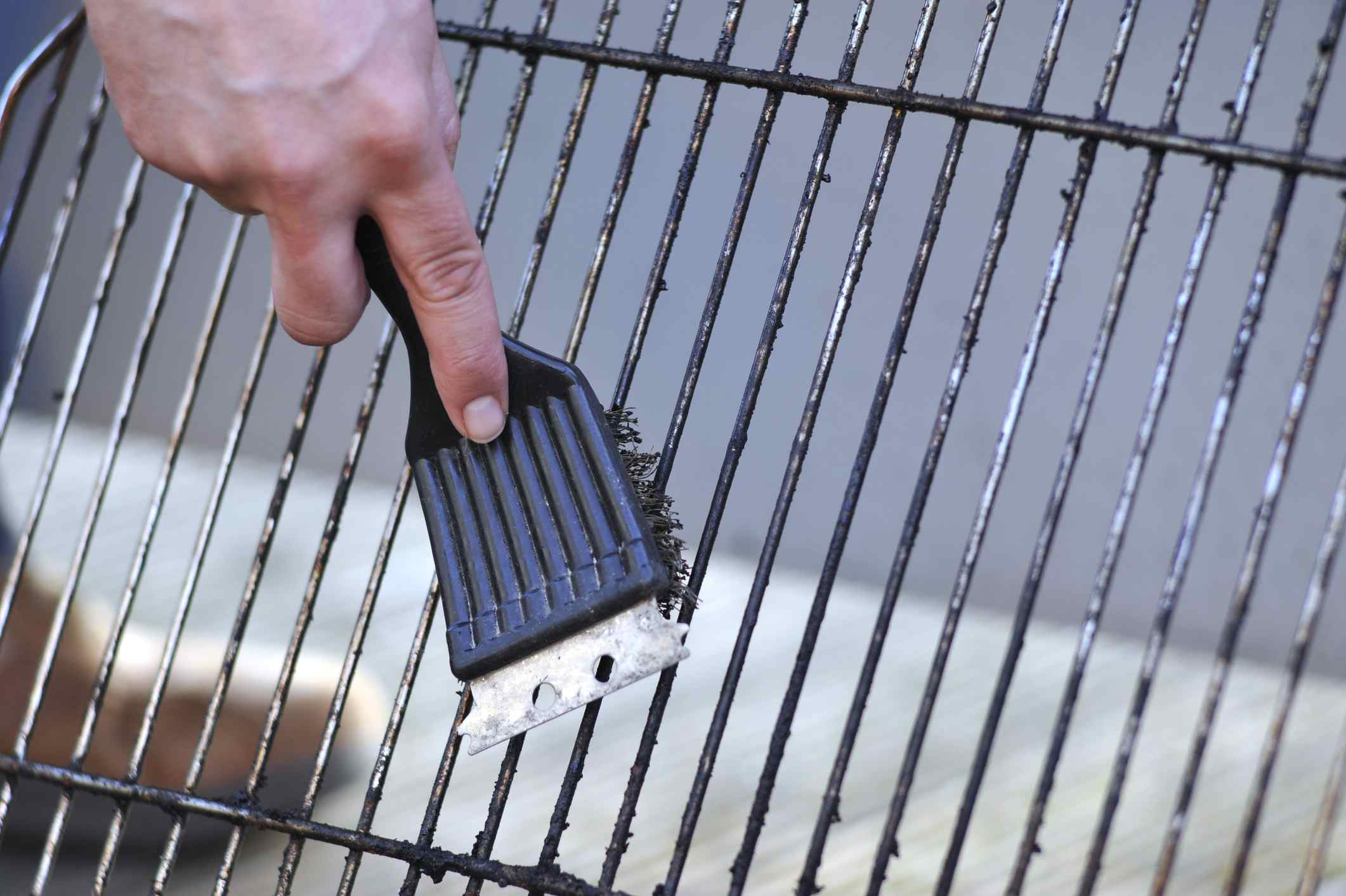 cleaning grates of grill