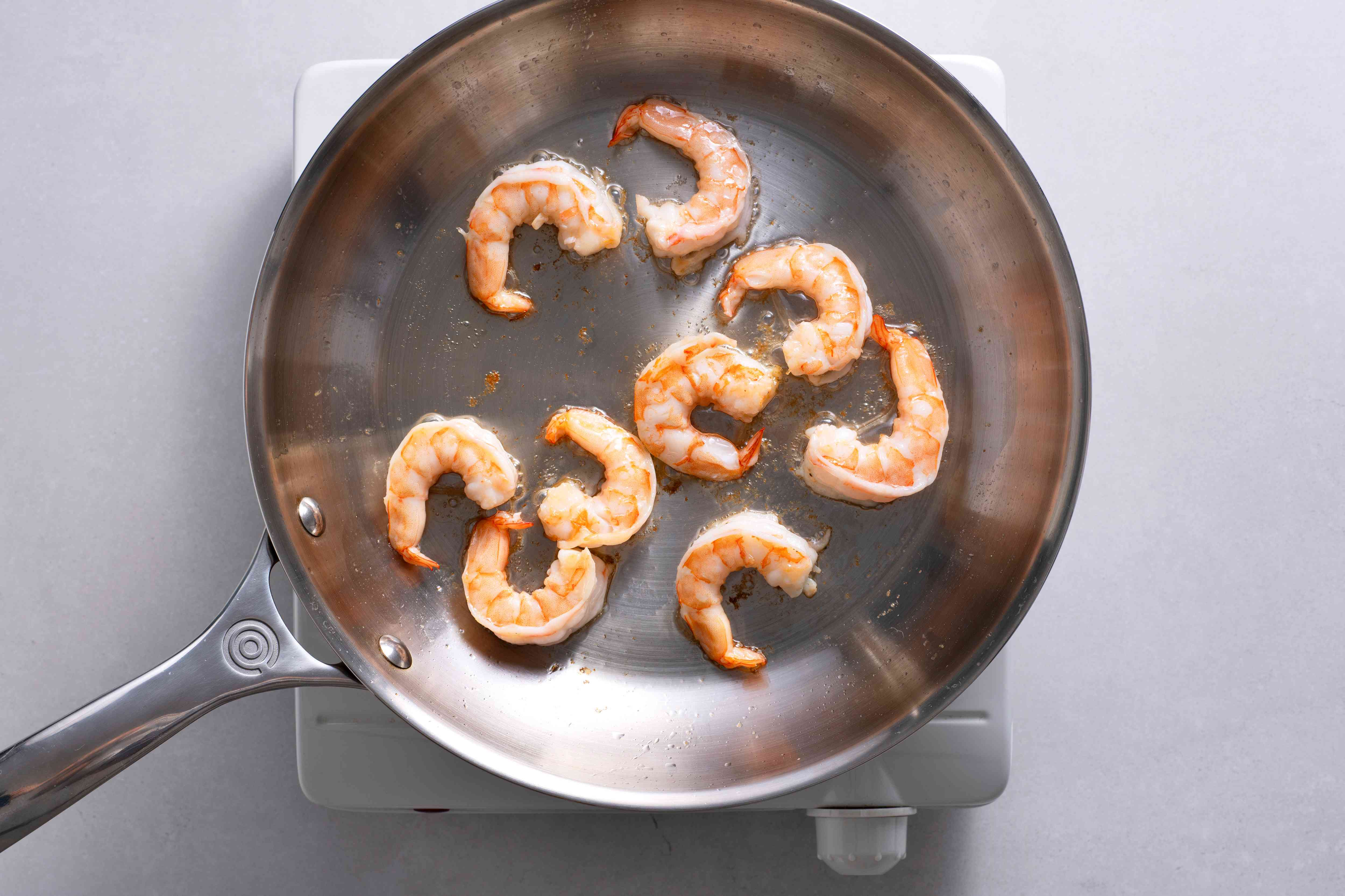 Shrimp cooking in a pan