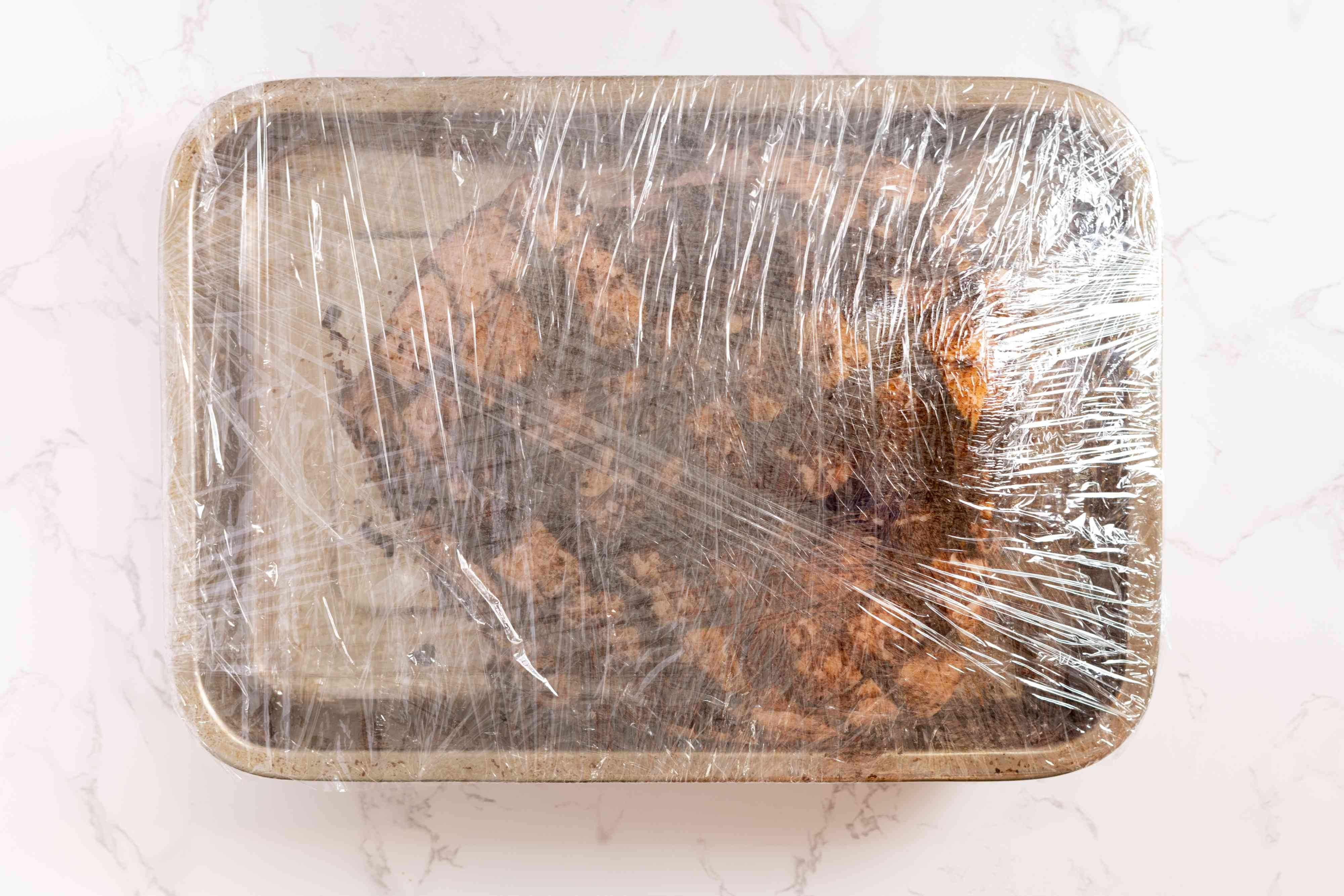 Place the pork in a roasting pan and cover with plastic wrap