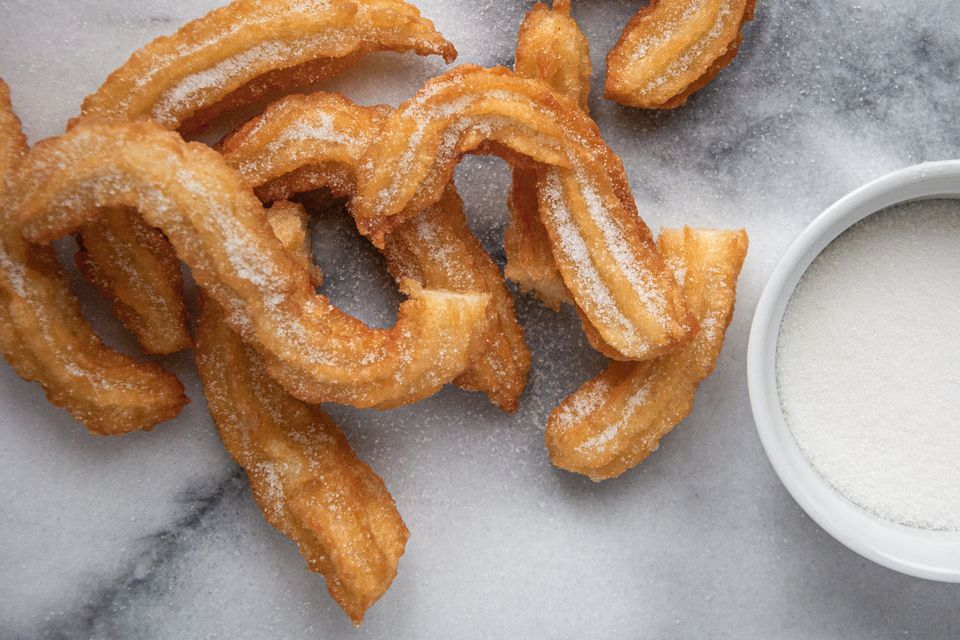 Easy Spanish Churros and sugar on a gray marble counter