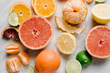 Variety of citrus fruits on marble surface