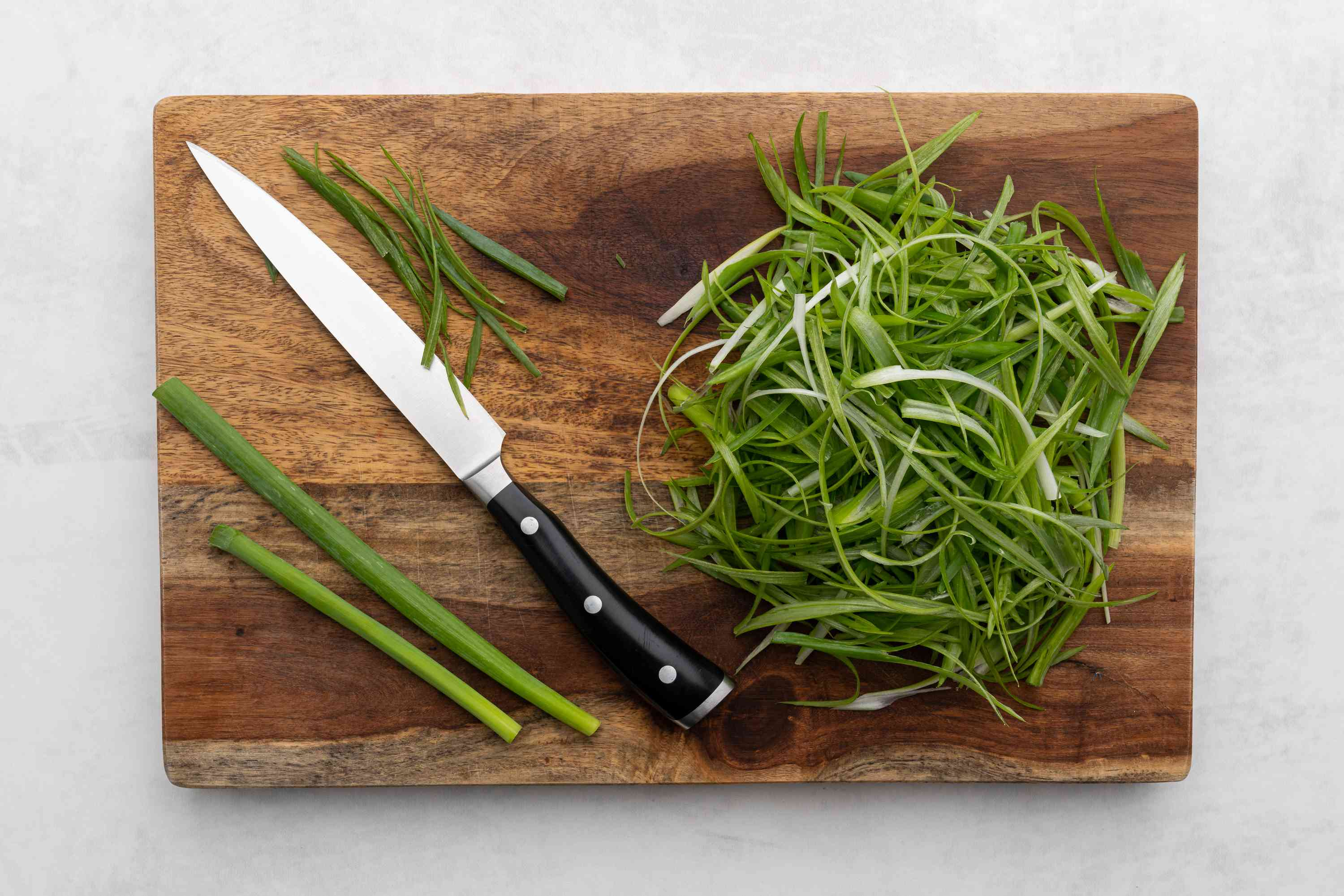 Cut the scallions into very thin strips on a cutting board
