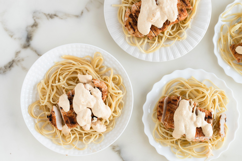 Arrange cooked linguine on serving plates