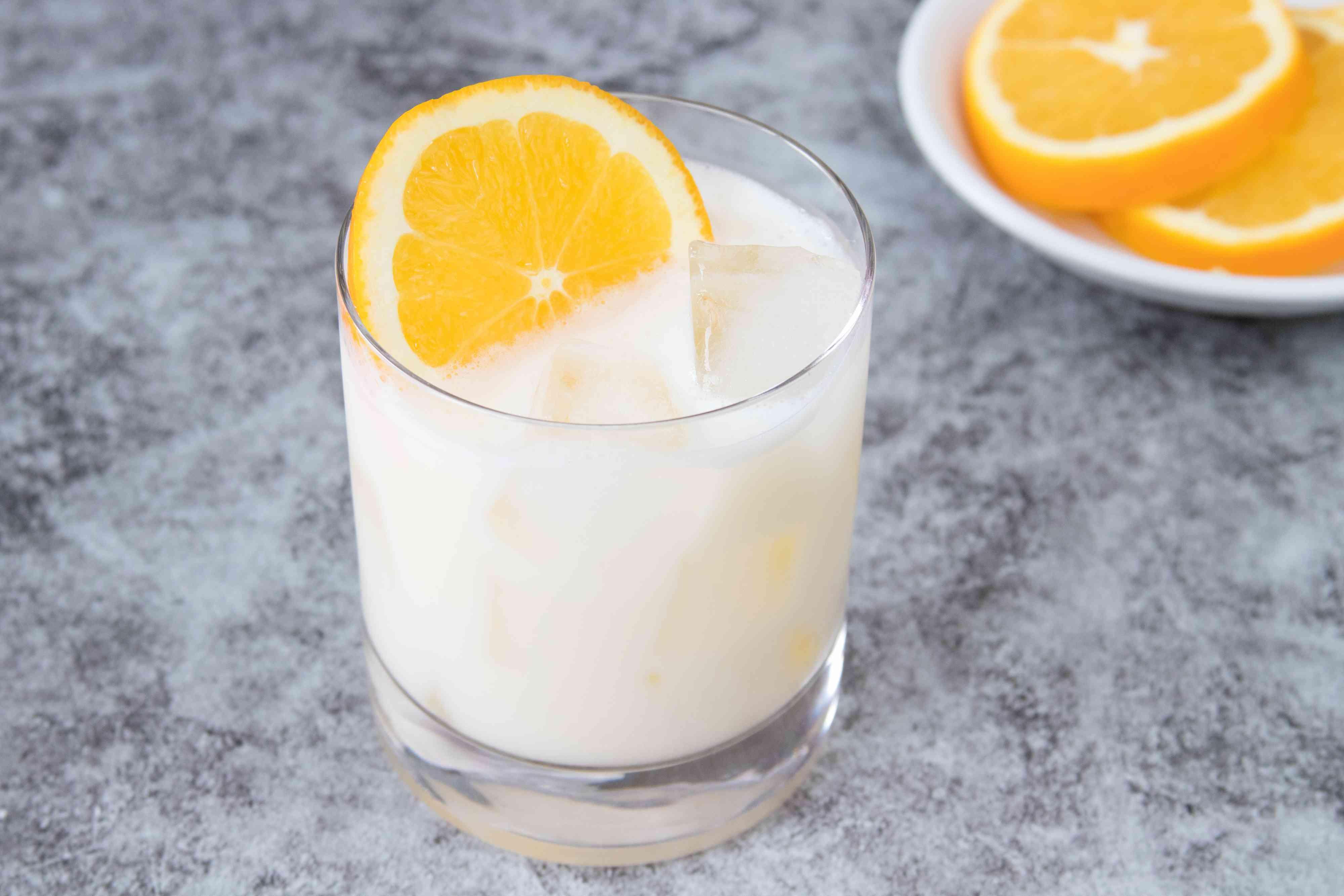 Orange creamsicle cocktail with orange slice garnish