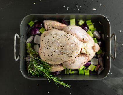 Raw chicken in roasting pan