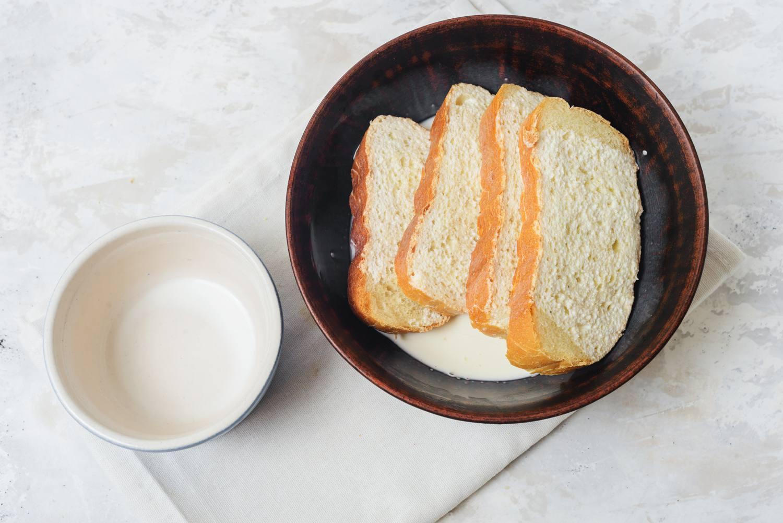Sliced bread soaking in milk