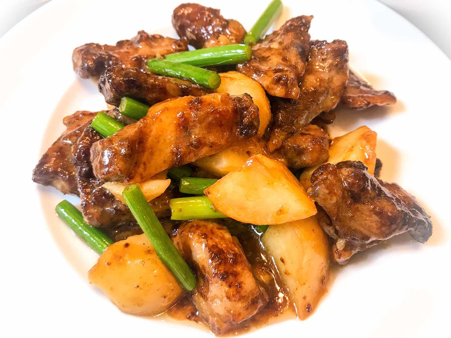 Braised pork soft bone spareribs with potatoes and garlic scapes