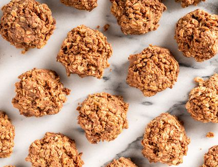no bake cookies arranged on marble surface in rows