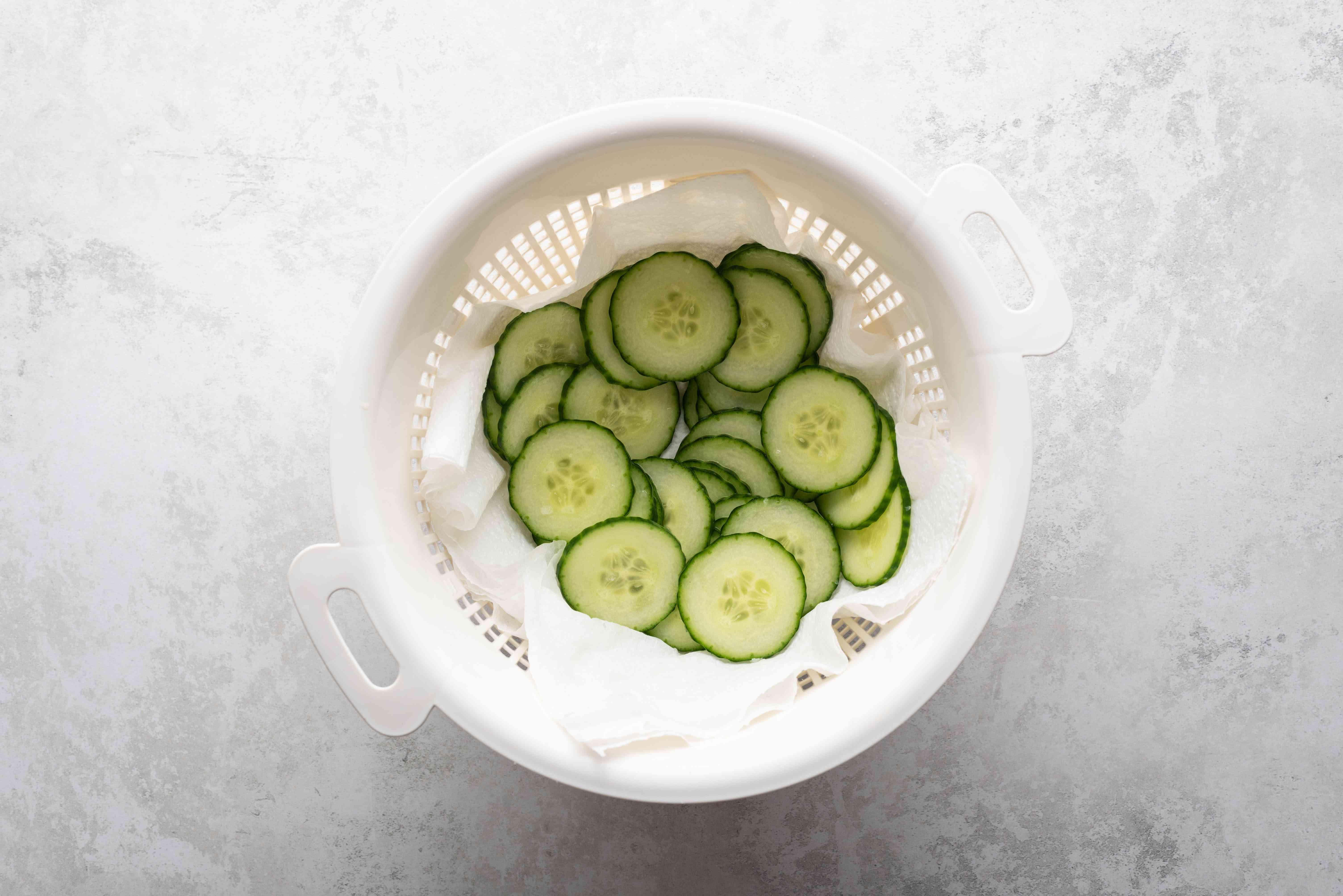 cucumber slices in a colander