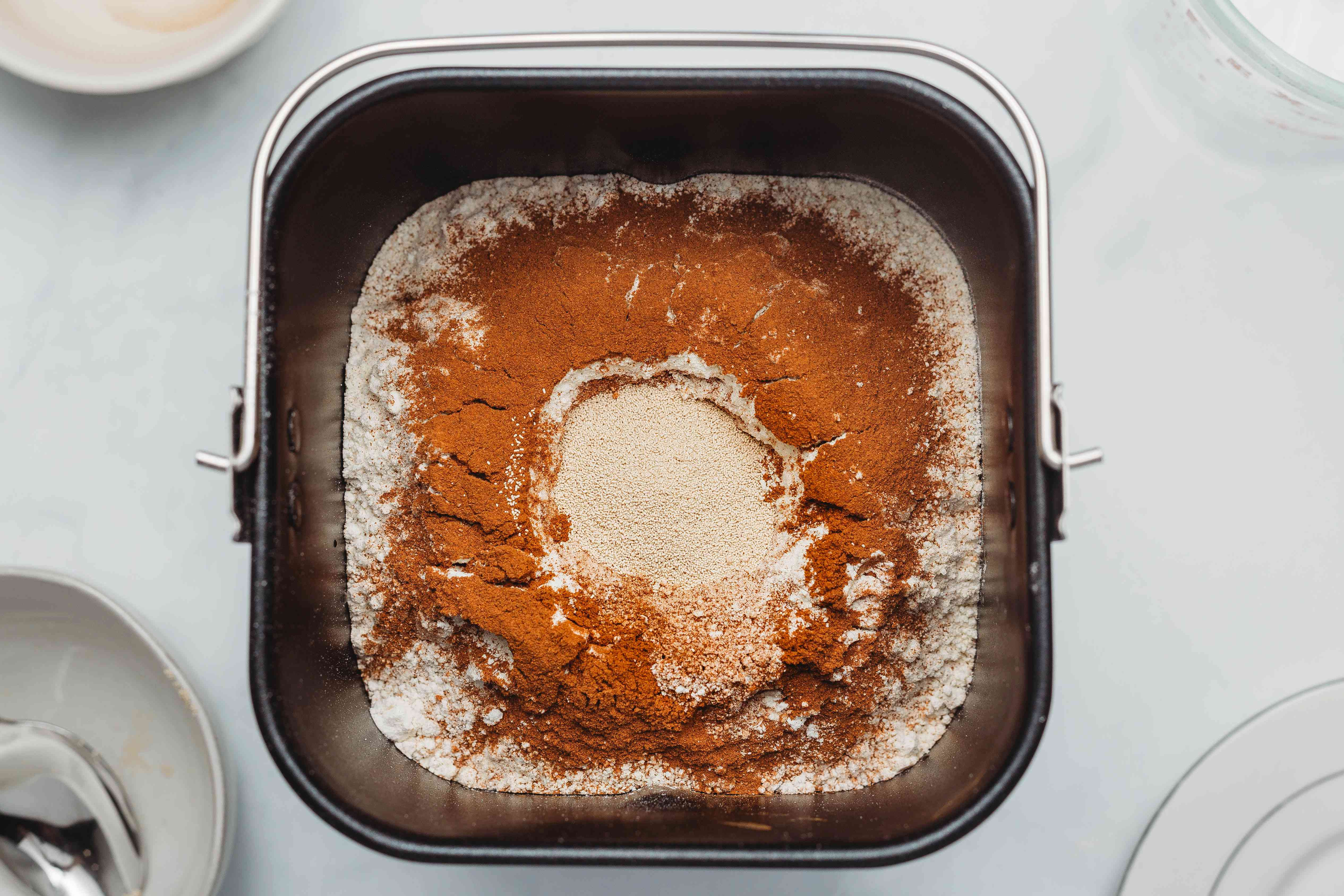 add dry yeast to the ingredients in the bread machine