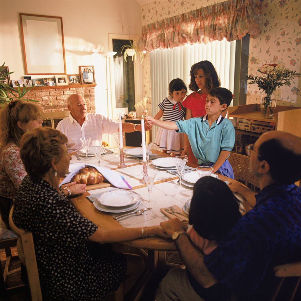 Jewish family gathers for Sabbath dinner