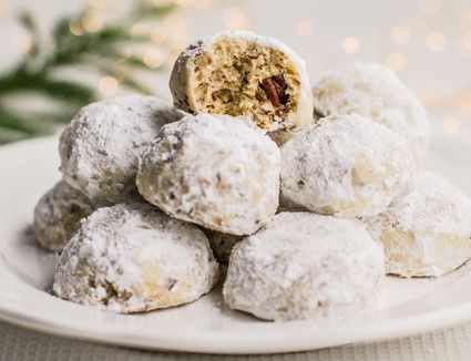 Pecan Butterball Cookies piled on plate