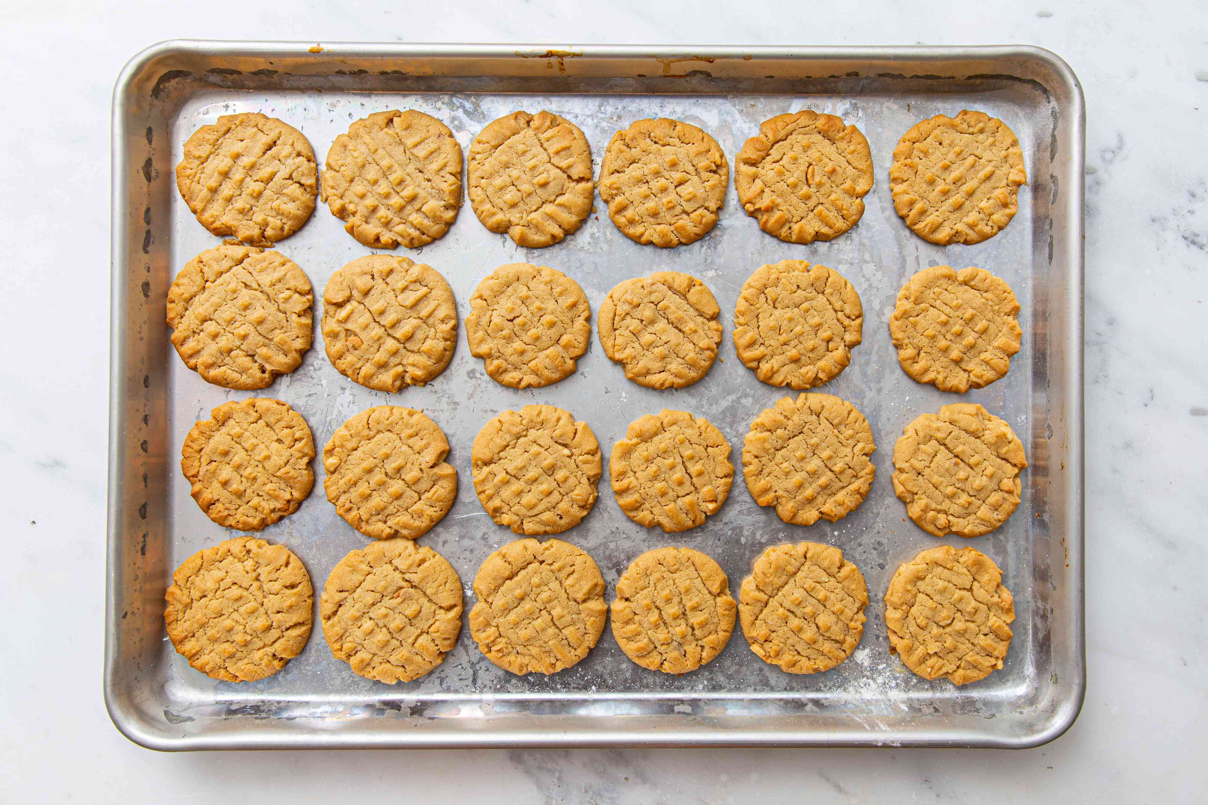 baked Crunchy Peanut Butter Cookies on a sheet pan