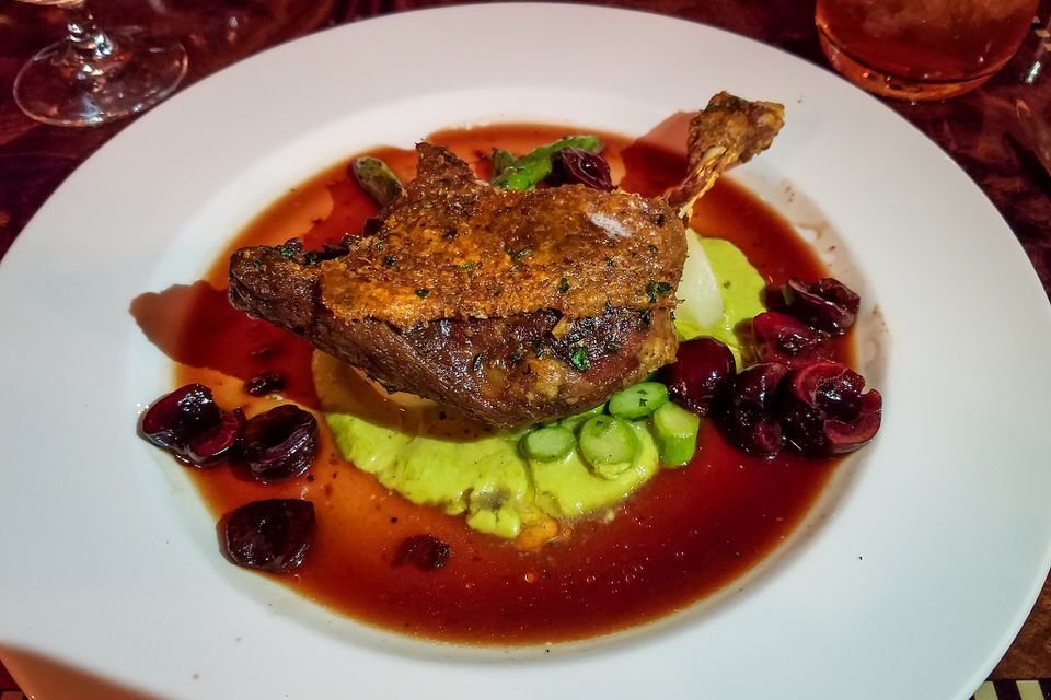Crispy Maple Leaf Duck Confit with Delta Asparagus, Baby Turnips, Cherry-Ancho Chili Vinaigrette–Carthay Circle Restaurant