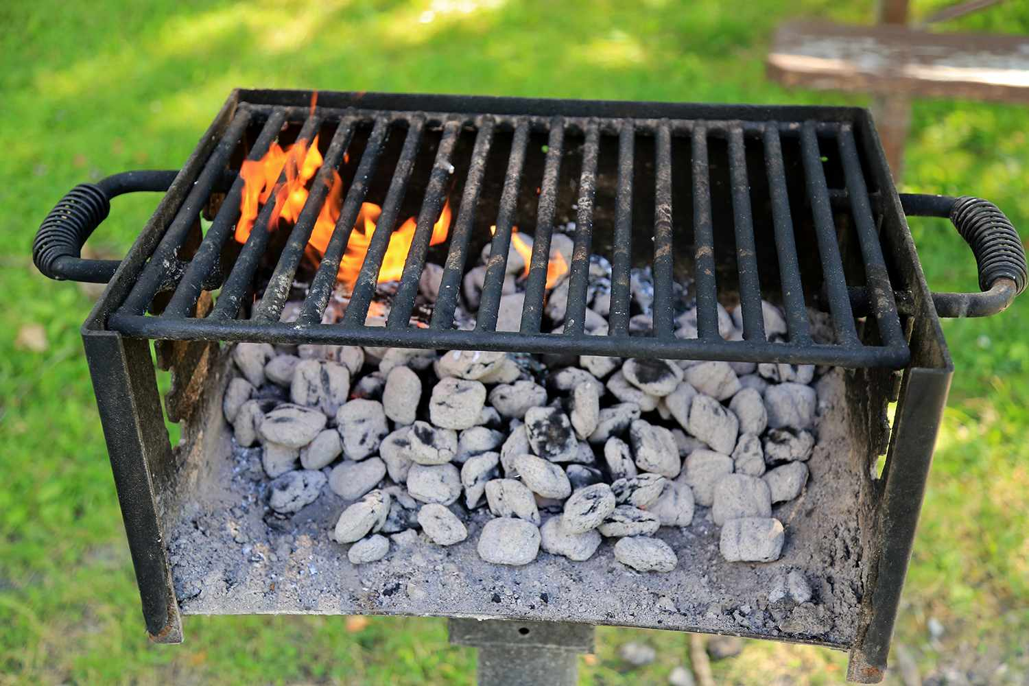 Burning charcoal on a outdoor BBQ grill