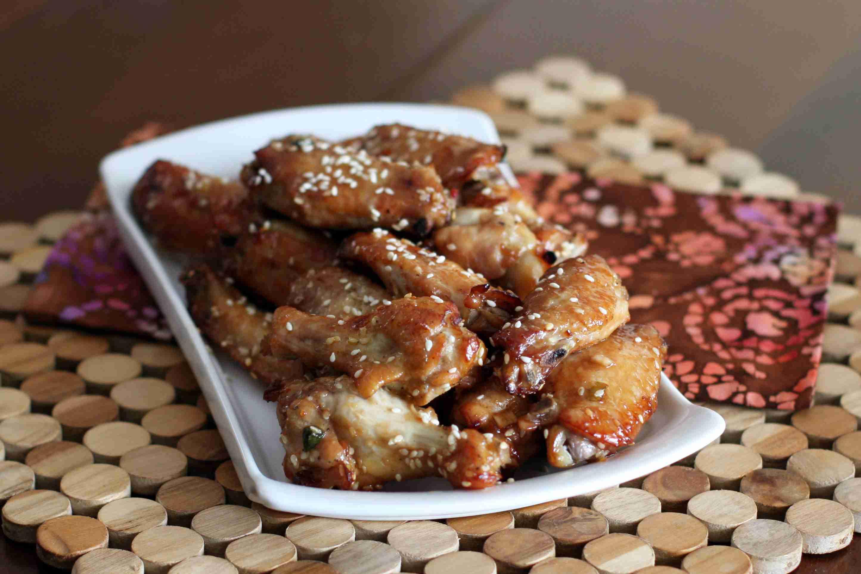 Sesame chicken wings on a rectangular white platter