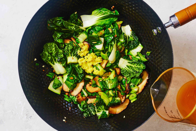 Bok Choy and Shiitake Mushroom Stir Fry cooking in a wok