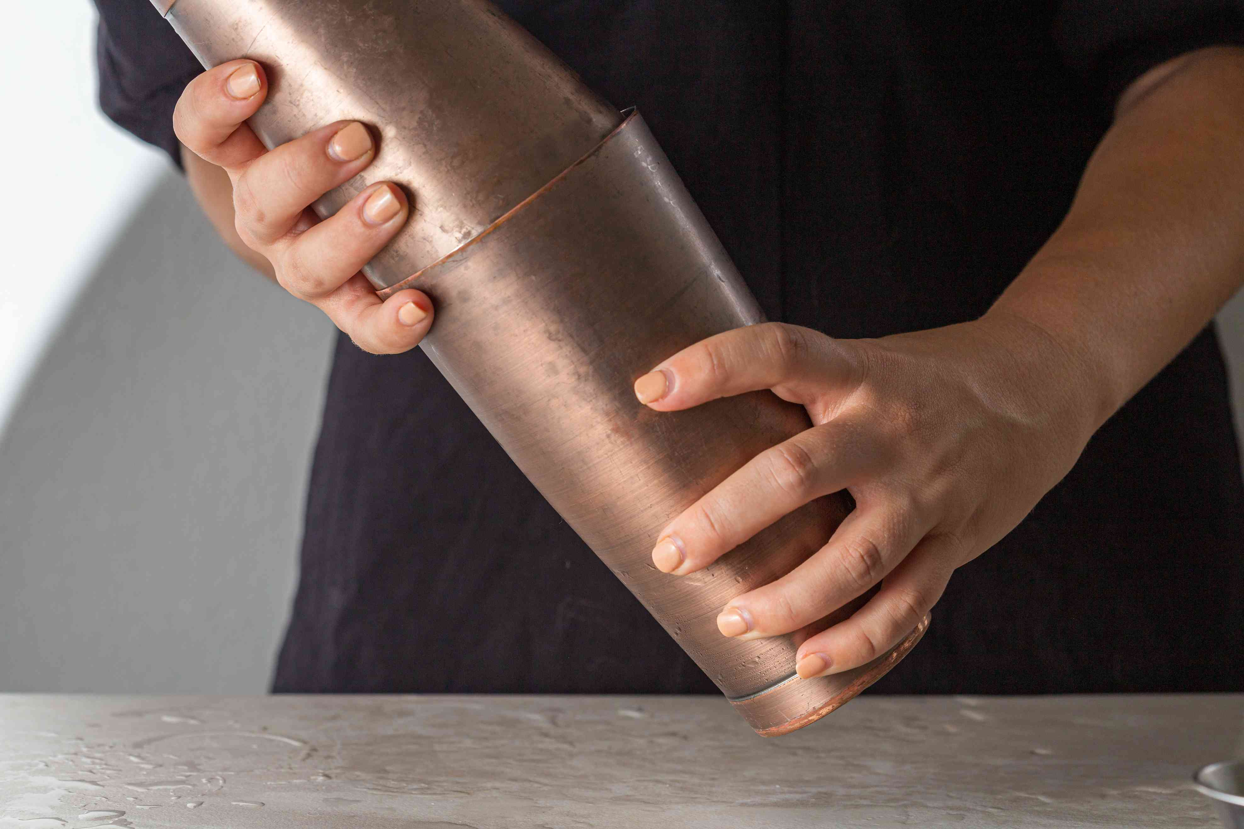 Shaking the cocktail ingredients in a shaker