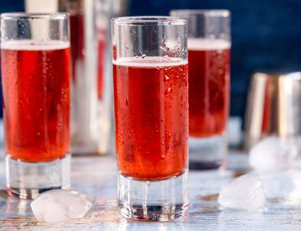 Red snapper shots lined up with ice around them