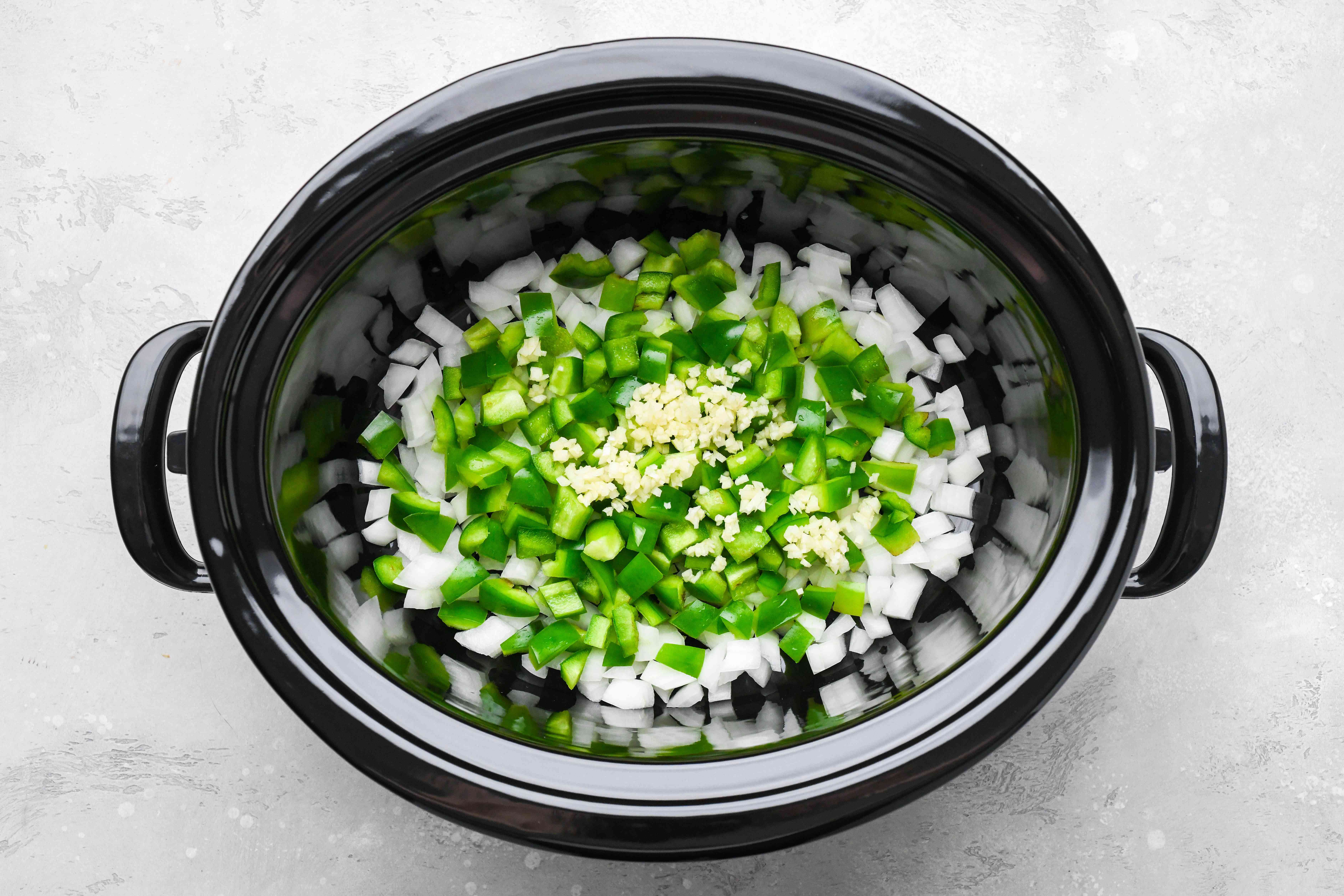 combine the onion, garlic, and the green bell pepper in a slow cooker