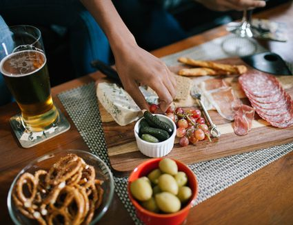 Indulging in a charcuterie at a house party - stock photo