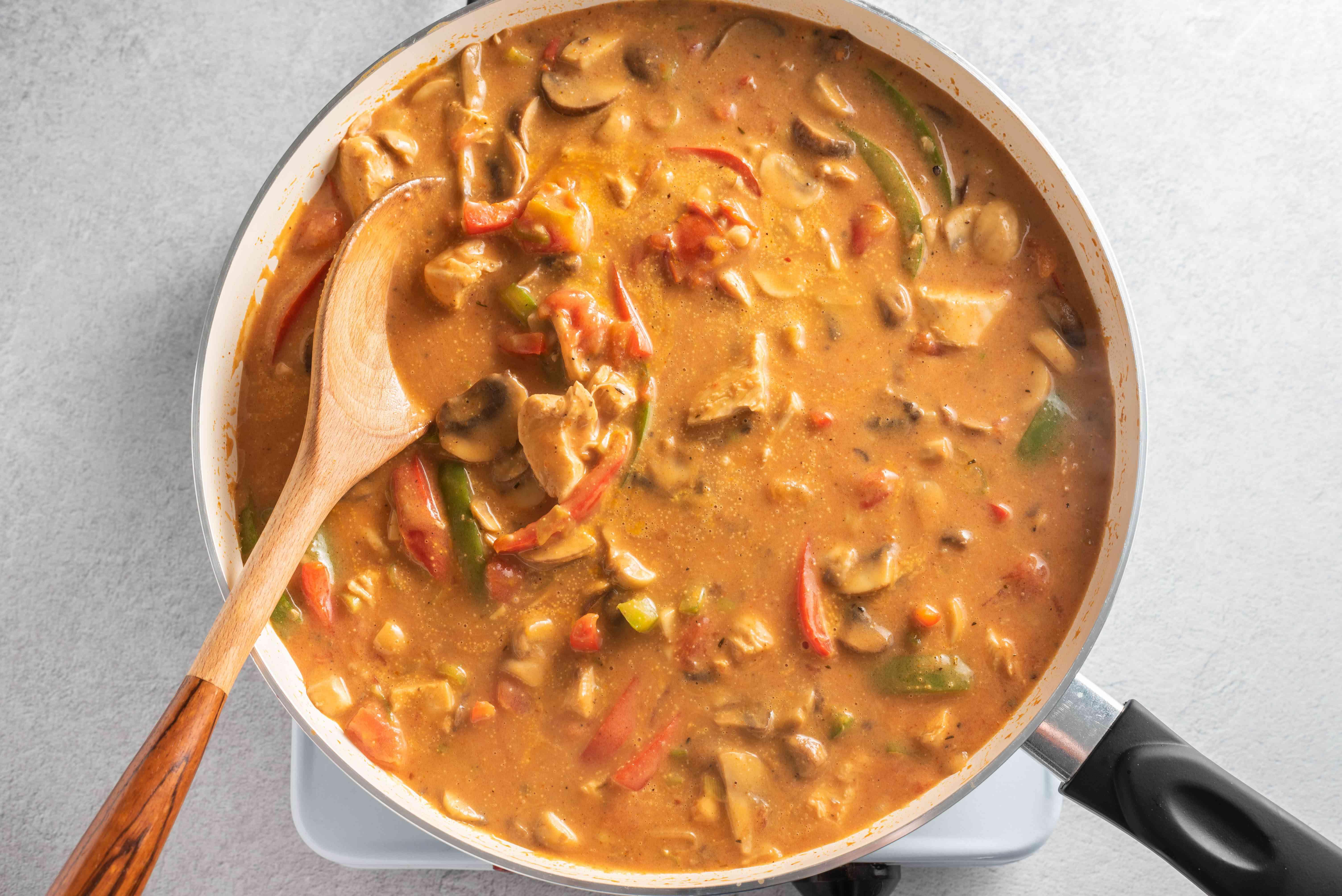 Add soup, milk, tomatoes