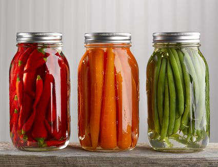 Peppers, carrots and green beans preserved in jars