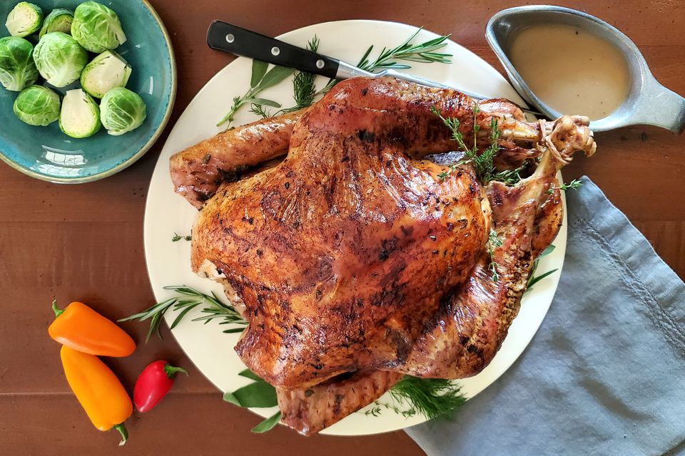 roast turkey on a table with vegetables