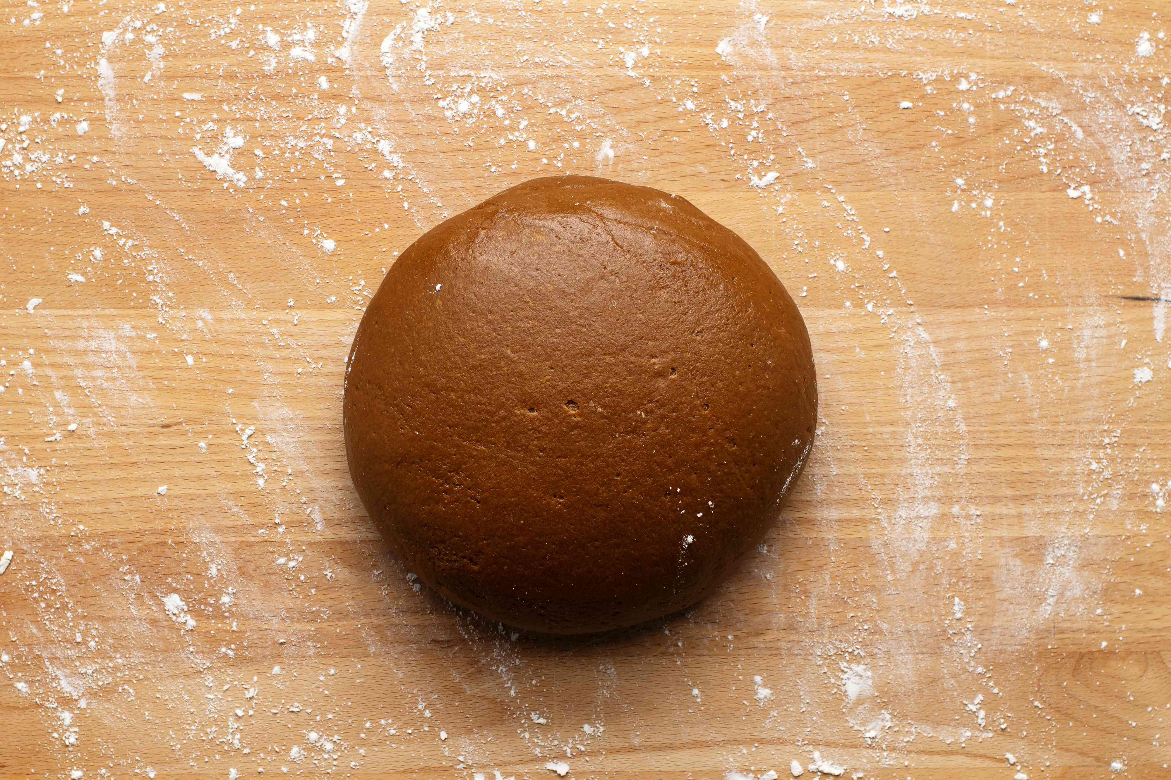 cookie dough ball on a floured surface