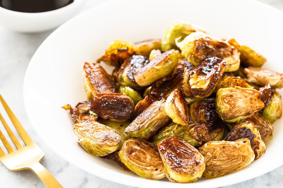 A bowl of oven-roasted Brussels sprouts with balsamic vinegar