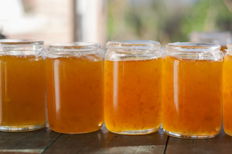 Jars of Homemade Marmalade on a wooden surface