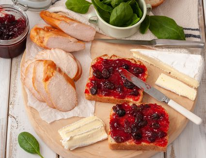 Smear cranberry on bread