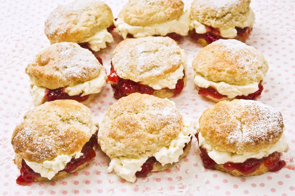 Nine scones with raspberry jam and cream