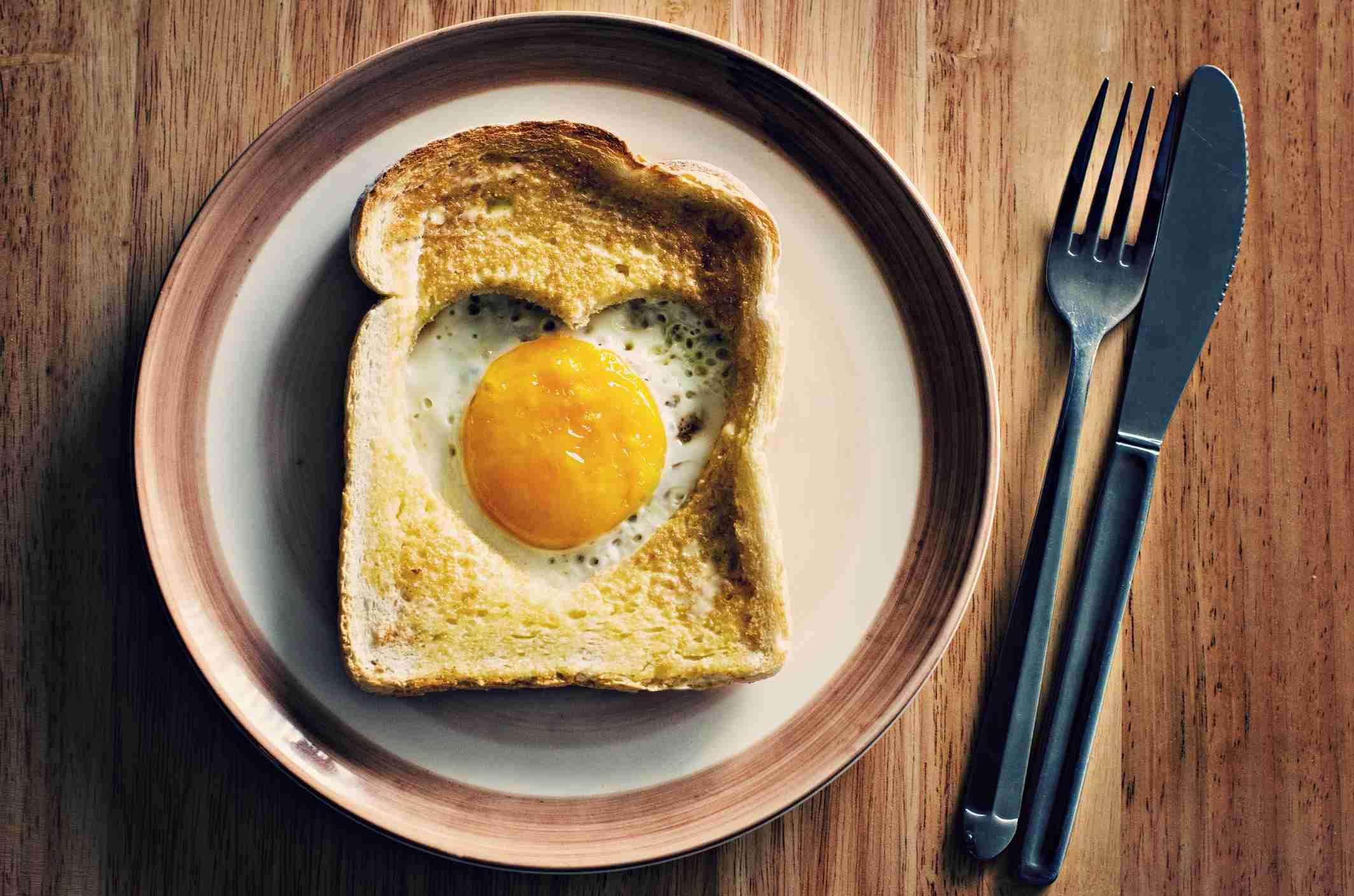 Heart shaped egg inside toast