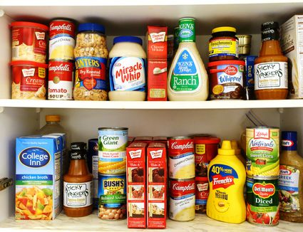Pantry stocked with dried goods and nonperishable foods