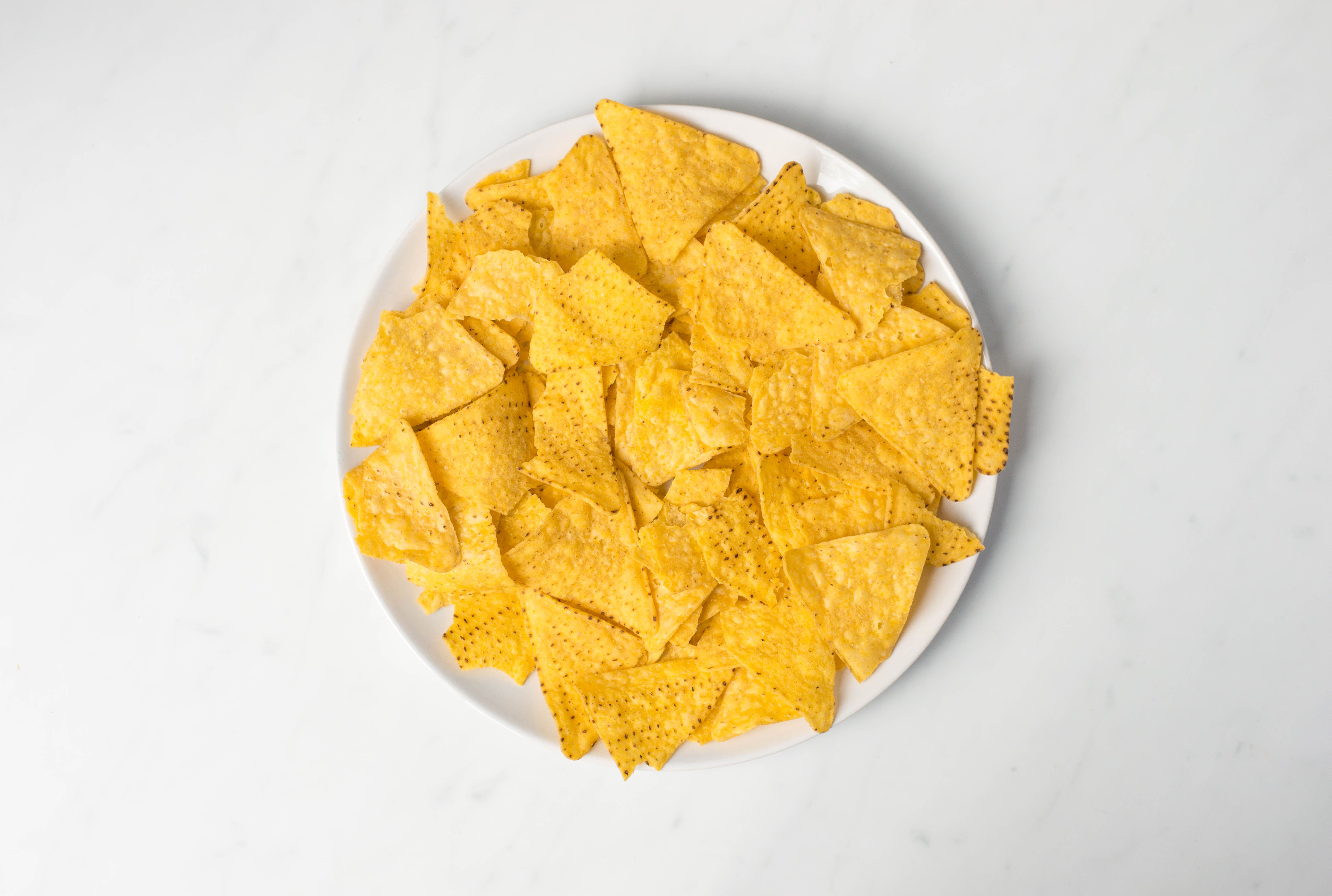 Tortilla chips on a microwave-safe plate