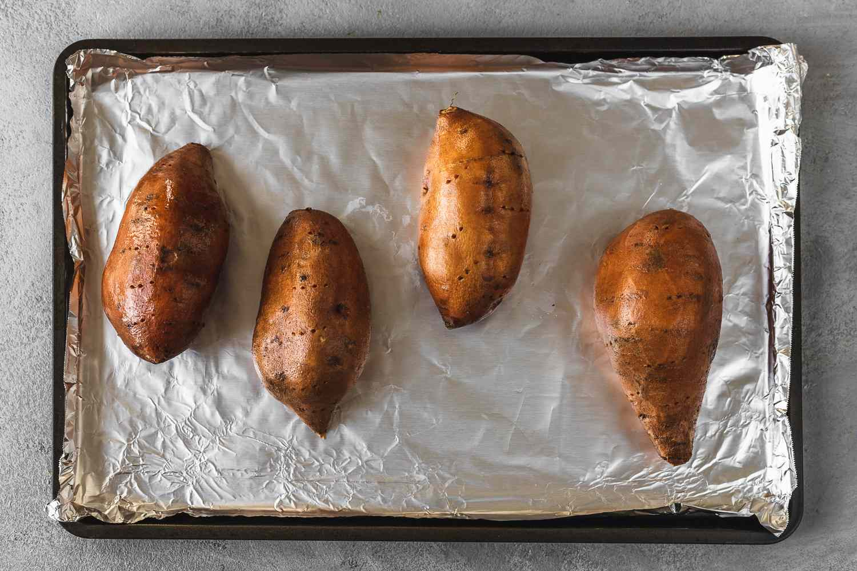 sweet potatoes on a baking pan