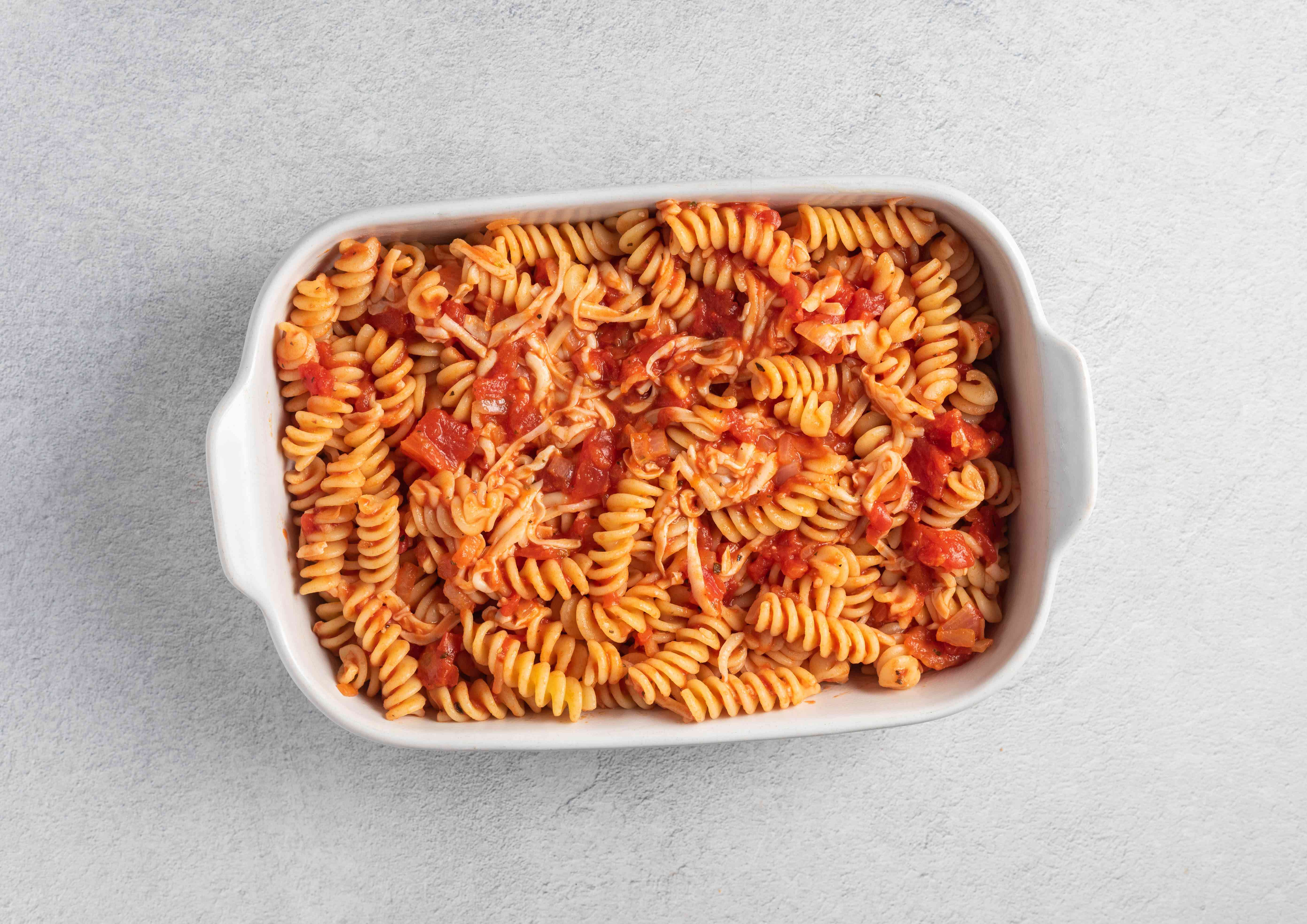 Stir the hot, cooked rotini