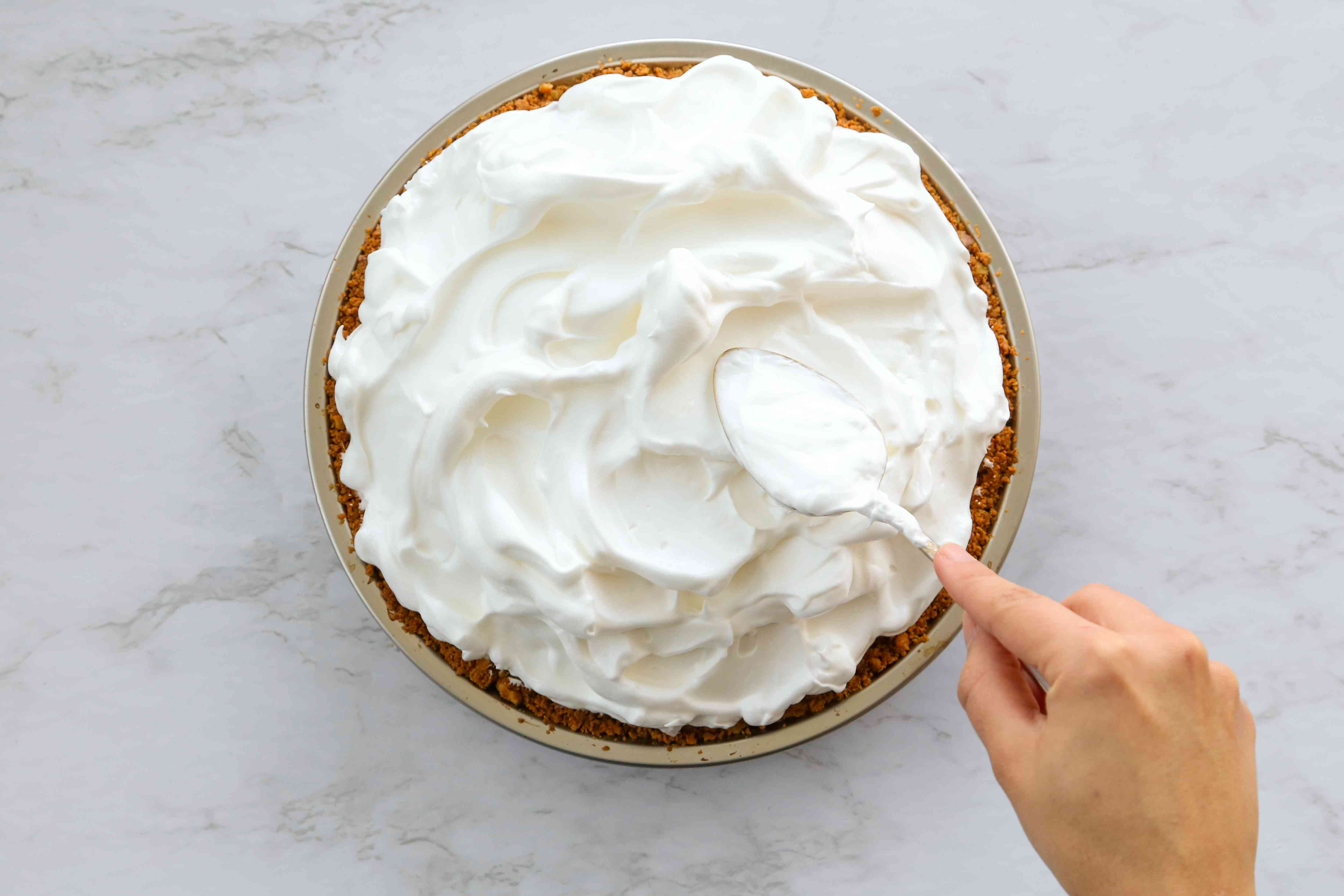 Use a spoon to make dips and swirls in the meringue
