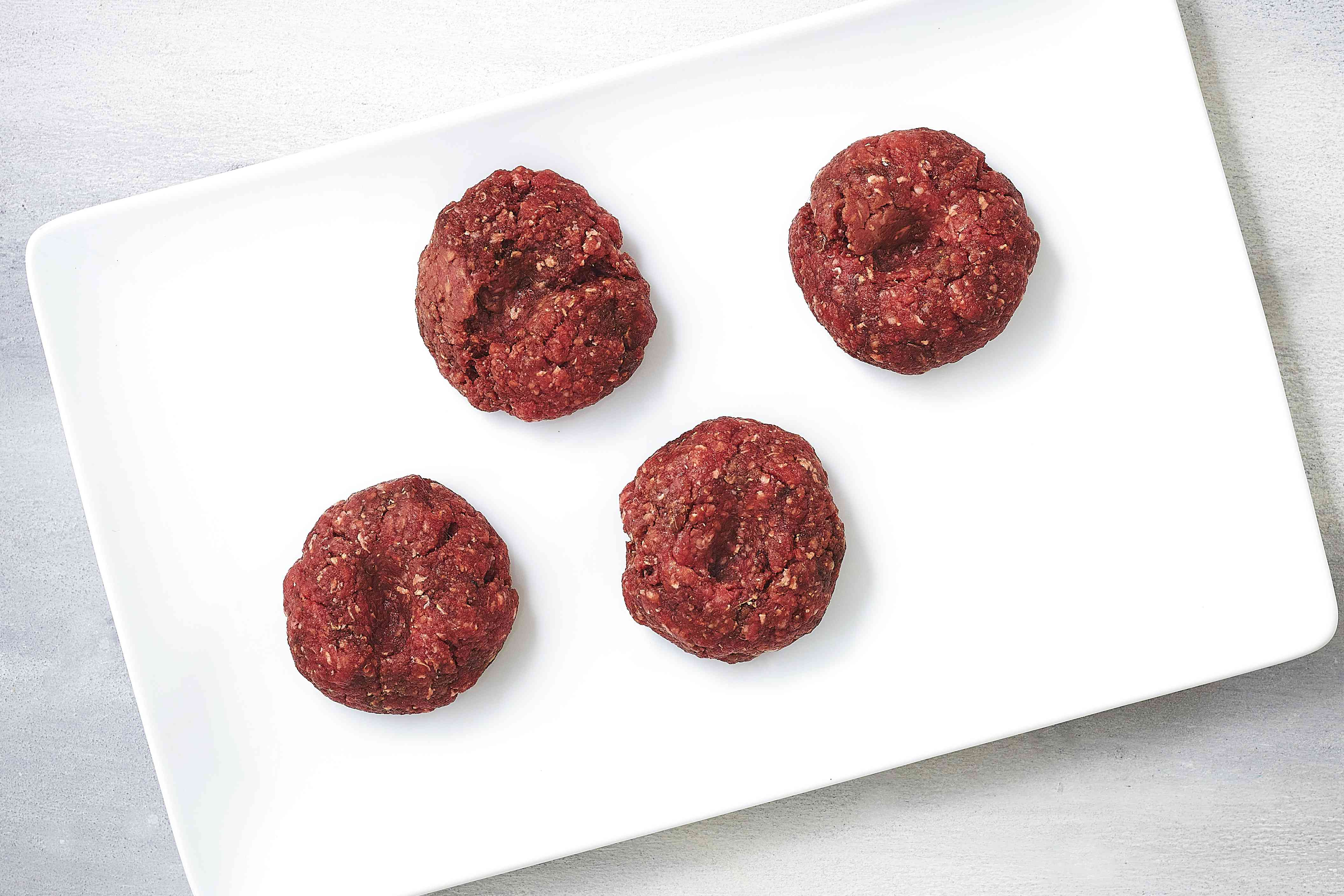burger patties with well in the middle