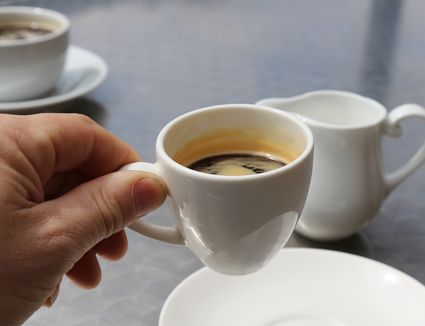 A cup of coffee in a white cup