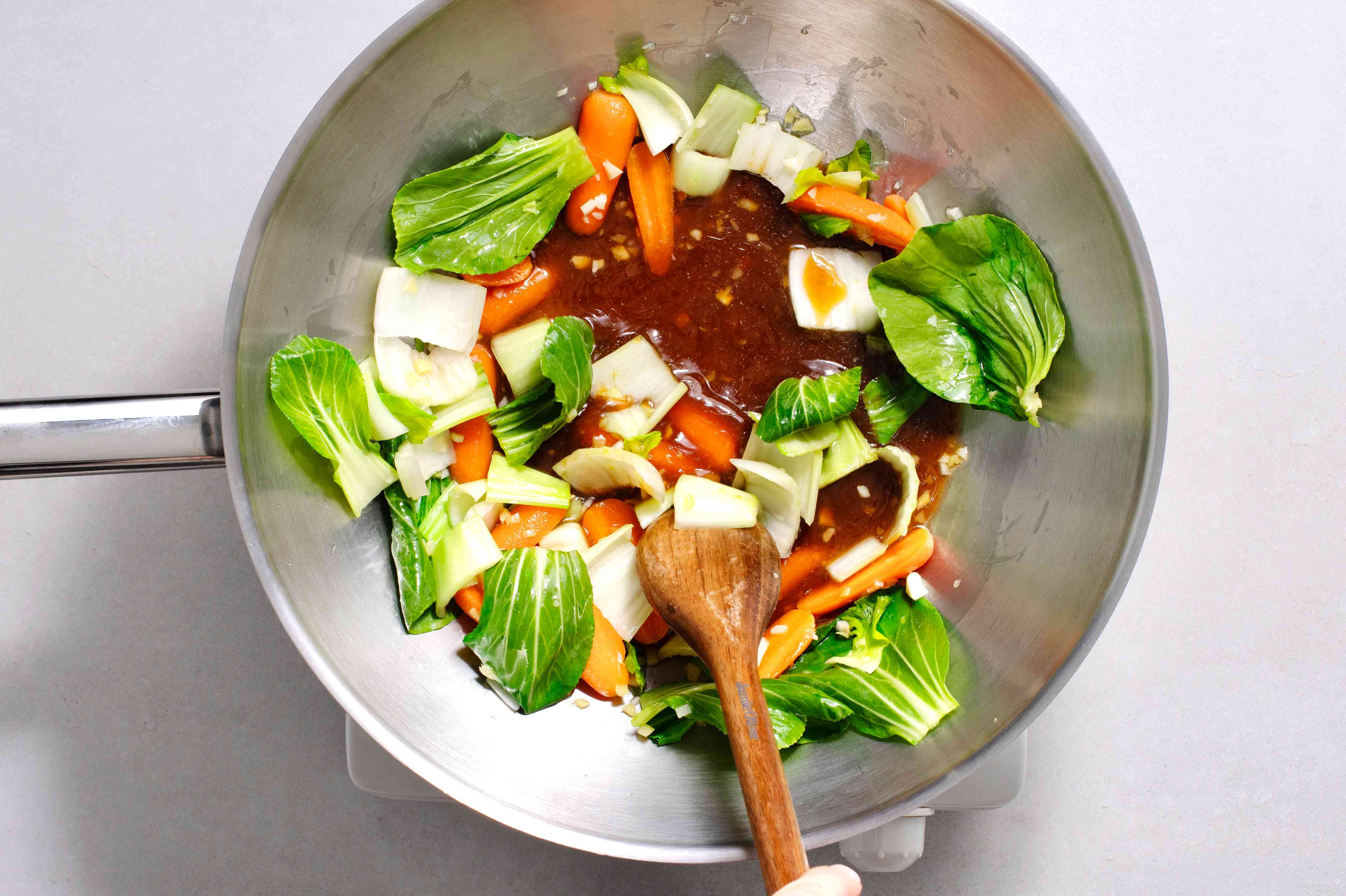 vegetables and sauce cooking in a wok