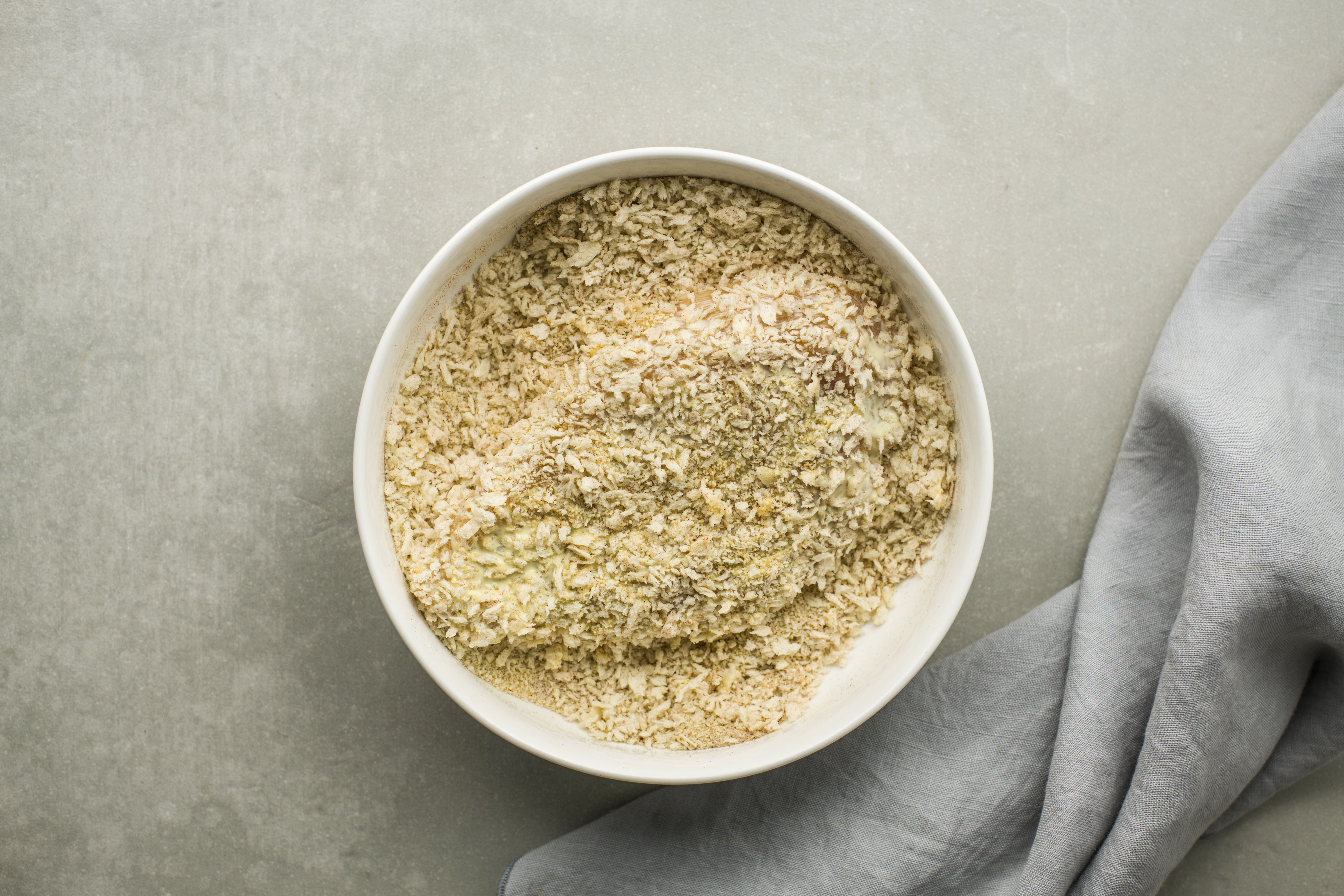Press the chicken breasts into breadcrumbs