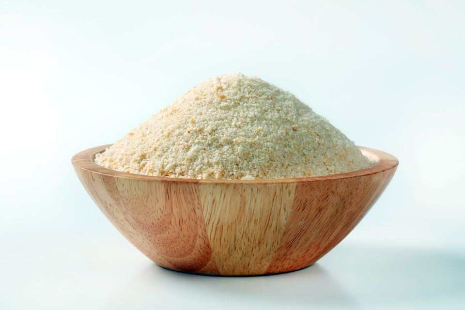 Fresh buttered breadcrumbs in a wooden bowl